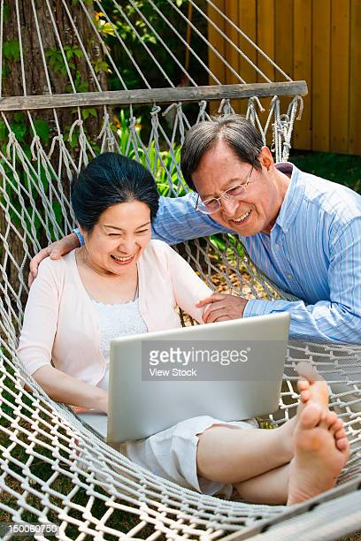 Mature couple looking at computer