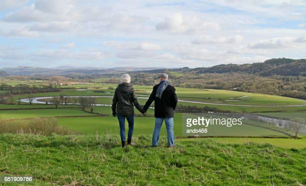 Mature couple looking at view of countryside