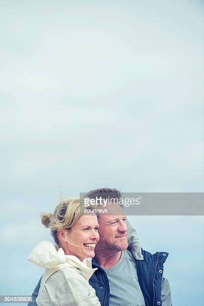 Mature couple looking at view.