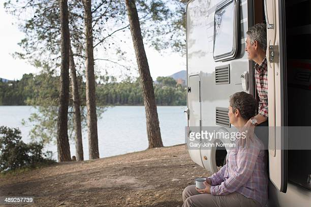mature couple looking out of their motorhome - norman elder stock photos and pictures