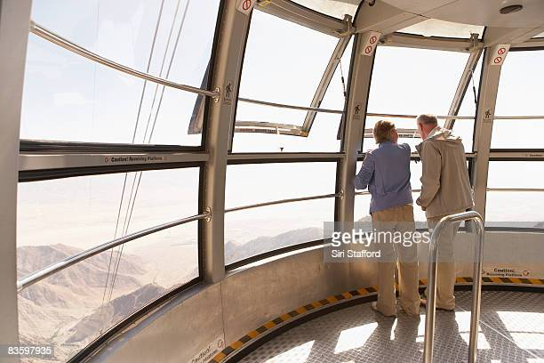 mature couple looking out window on tram - palm springs stock pictures, royalty-free photos & images