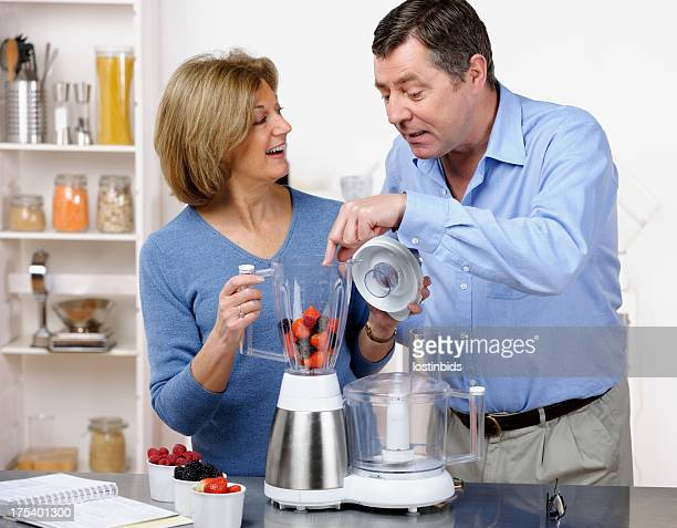 Mature Couple Making Healthy Drink/ Dessert Together