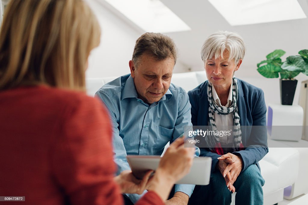 Mature Couple Meeting with Financial Advisor : Stock Photo