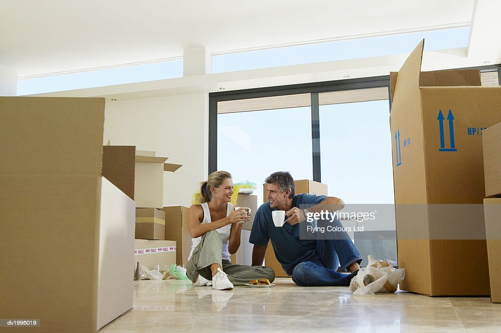 Mature Couple Moving into an Apartment, Taking a Coffee Break : Stock Photo