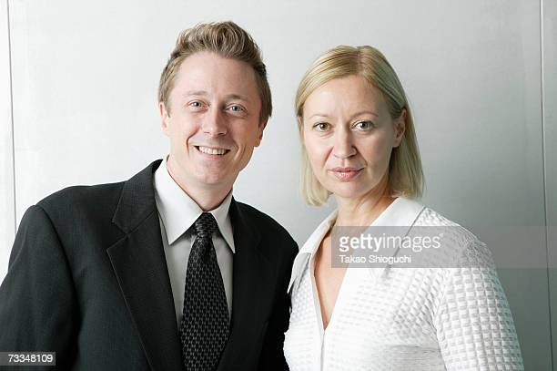 Mature couple of business people standing together, portrait