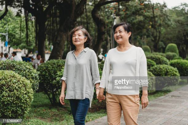 Mature couple of ladies walking together in the city