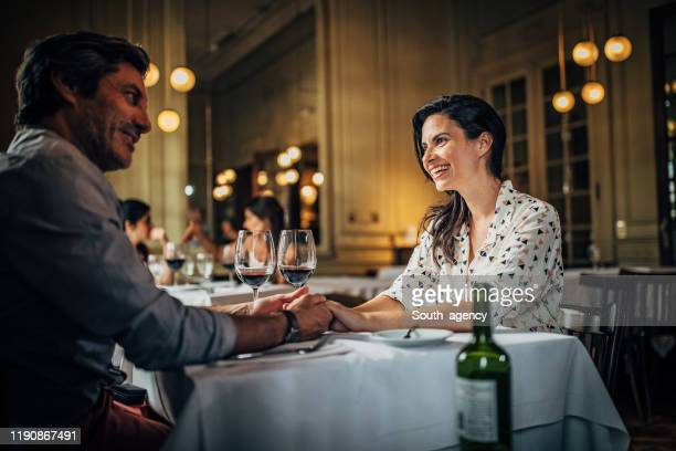 mature couple on a date - romantic dinner stock pictures, royalty-free photos & images