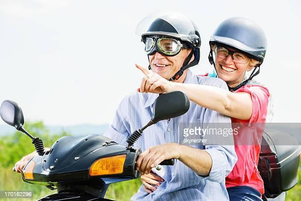 Mature couple on a motorbike.