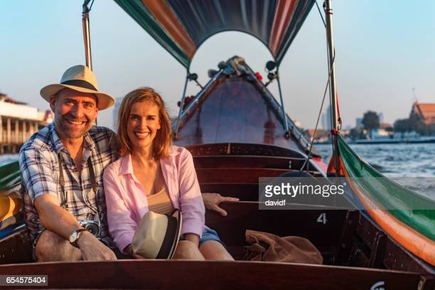 Mature Couple on a Romantic Sunset Boat Cruise on the River in Bangkok Thailand