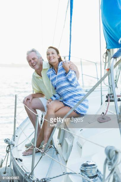 Mature couple on a sailboat