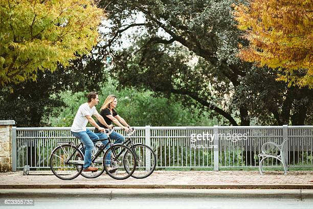 mature couple on bikes in austin texas - austin texas fotografías e imágenes de stock