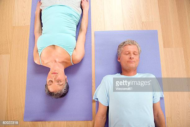 mature couple on gymnastic mat, smiling, portrait - 50 59 years stock pictures, royalty-free photos & images