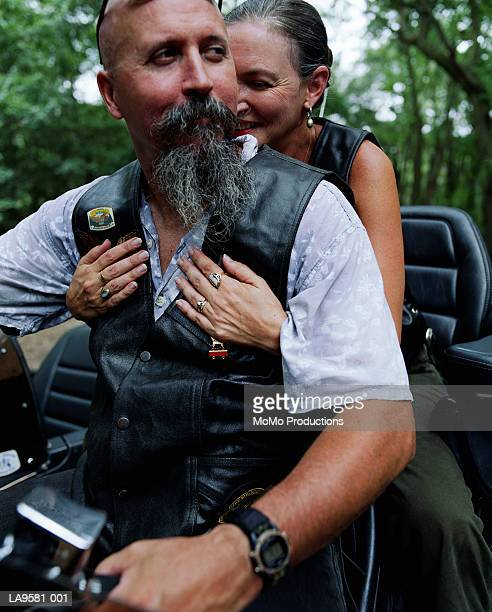 mature couple on motorbike - biker jacket stock photos and pictures