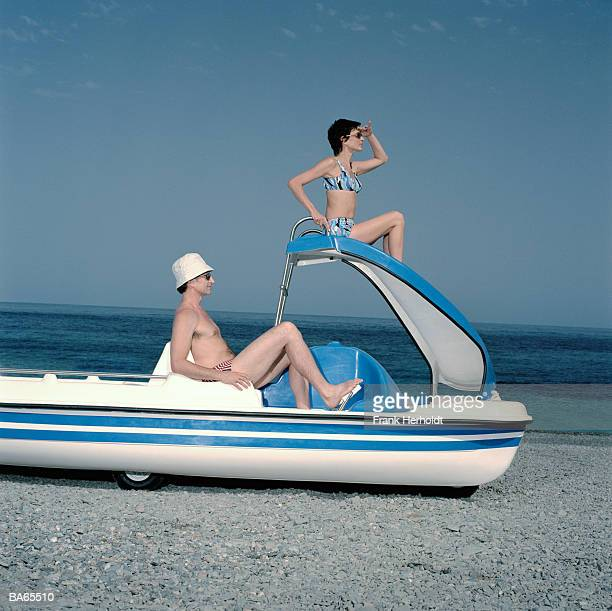 mature couple on peddalo on beach - pedal boat stock pictures, royalty-free photos & images