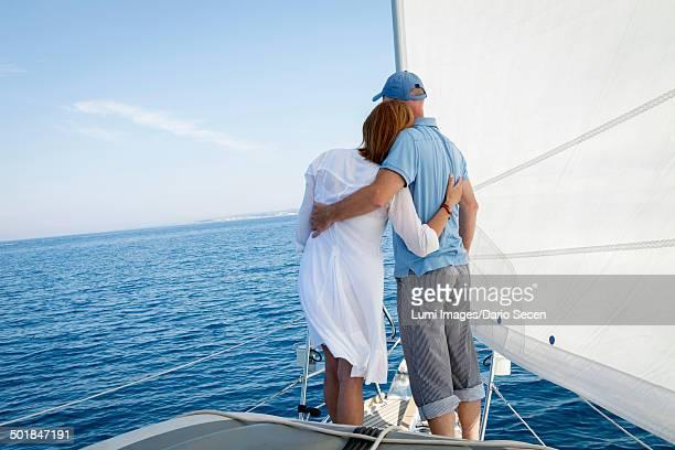 Mature couple on sailboat, looking at view, Adriatic Sea, Croatia