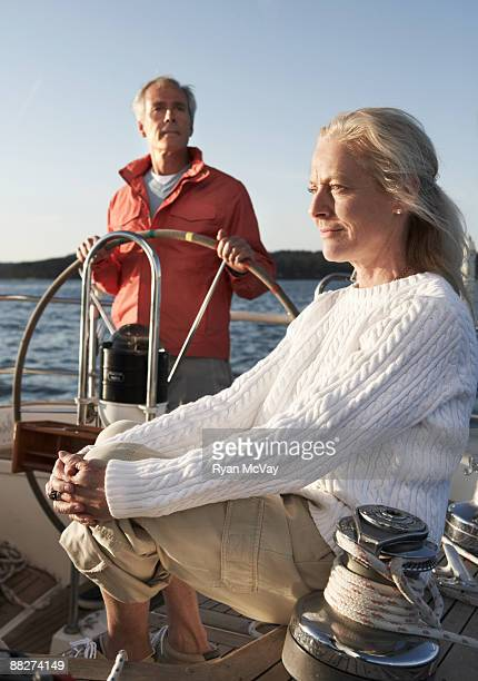 mature couple on sailboat - kitsap county washington state stock pictures, royalty-free photos & images