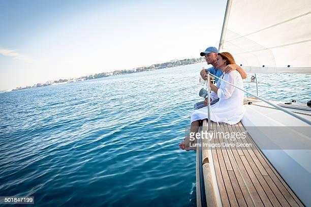 Mature couple on sailboat, relaxing, Adriatic Sea, Croatia