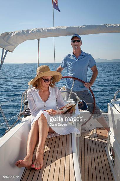 Mature couple on sailboat, using digital tablet, Adriatic Sea, Croatia