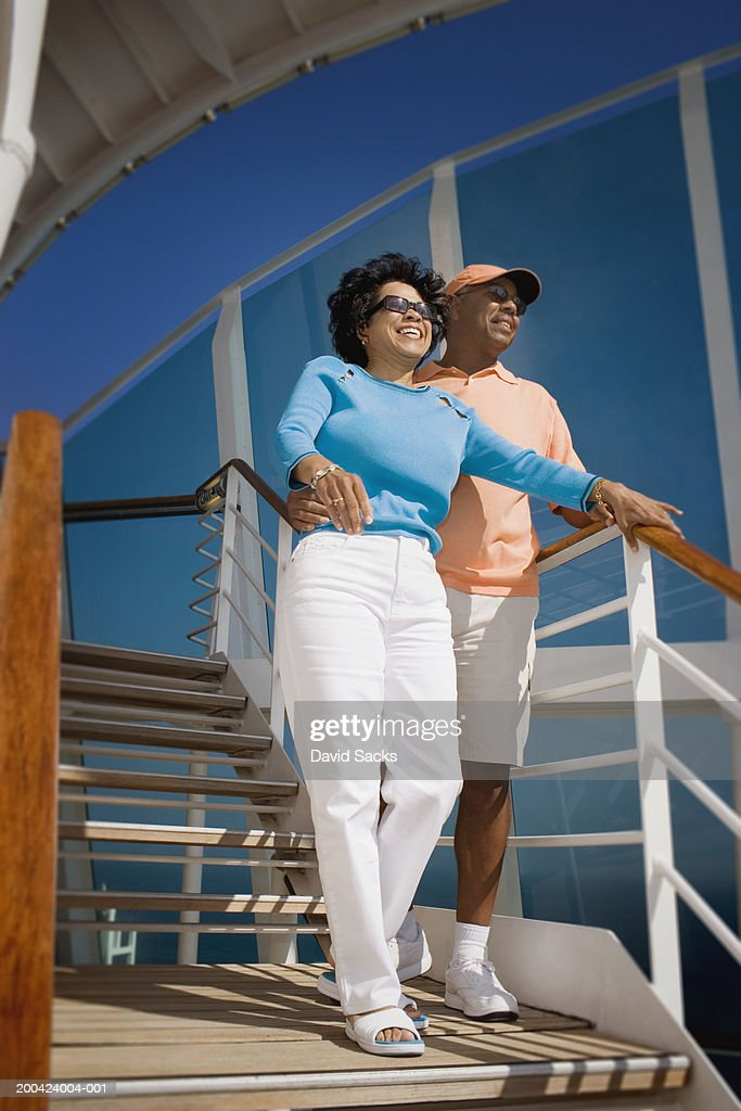 Mature Couple On Steps Of Cruise Ship Smiling Stock Photo