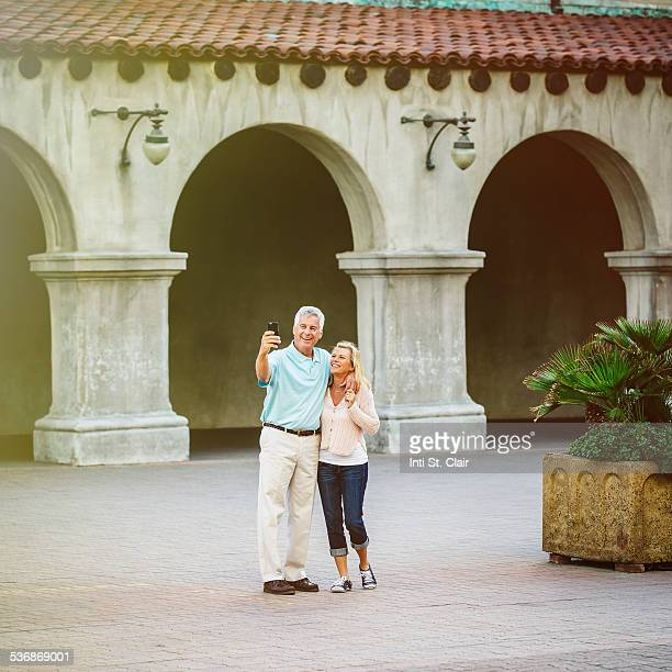 Mature couple on vacation taking selfie with phone