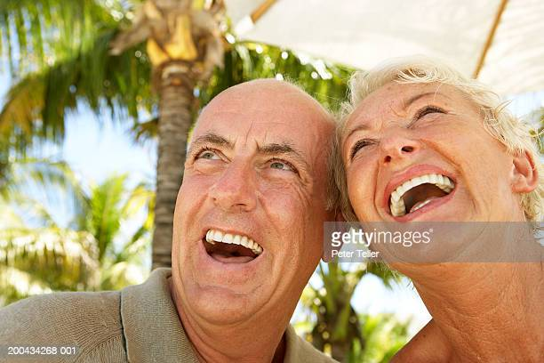 Mature couple outside, laughing, close up