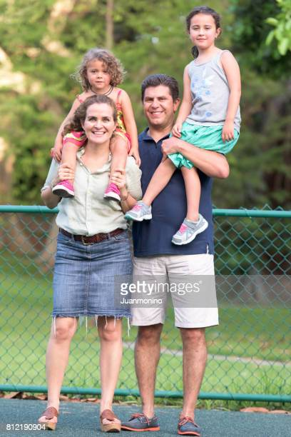 mature couple posing with their children - stereotypically middle class stock photos and pictures