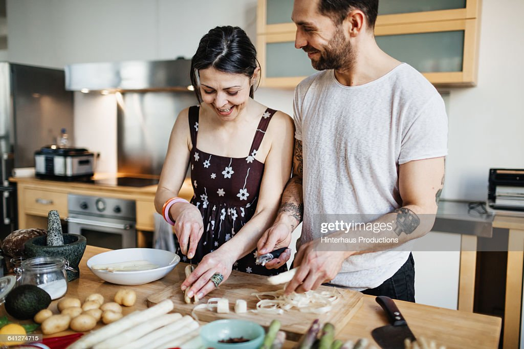 Mature couple preparing food for dinner : Photo