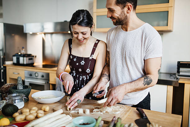 mature couple preparing food for dinner - preparation stock pictures, royalty-free photos & images