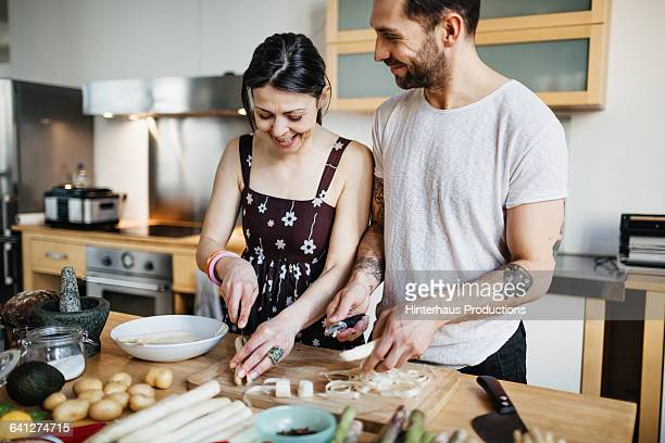 mature couple preparing food for dinner - ungestellt stock-fotos und bilder