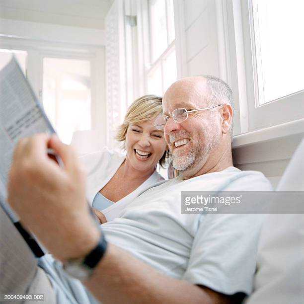 Mature couple reading in bed