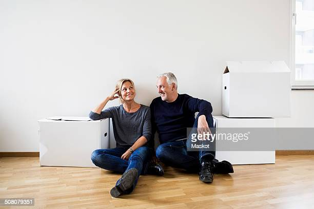 Mature couple relaxing after moving into their new house
