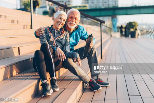 mature couple relaxing after work out - active seniors stock pictures, royalty-free photos & images