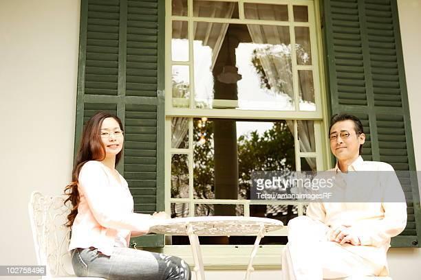 Mature couple relaxing at backyard