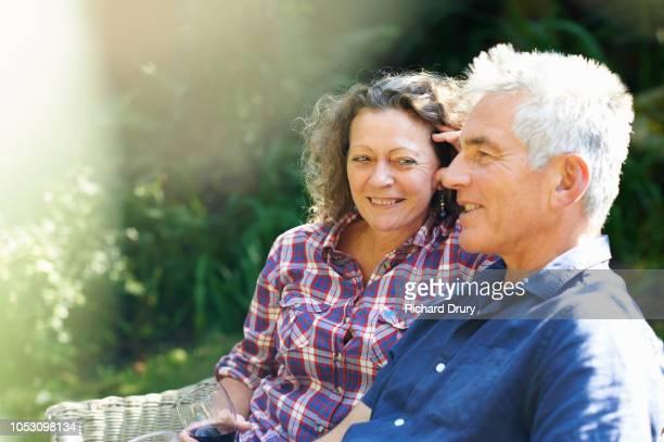 Mature couple relaxing in their garden
