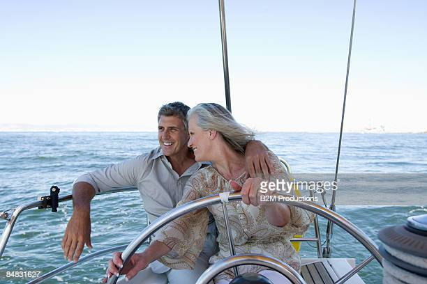 Mature couple relaxing on a sailboat