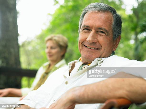 mature couple relaxing outdoors, man, smiling, close-up - 50 59 years stock pictures, royalty-free photos & images