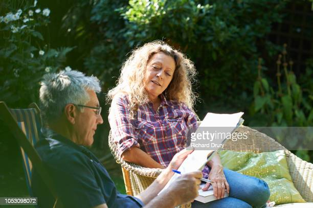 Mature couple relaxing together in their garden