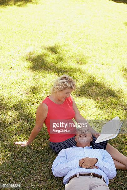 Mature couple relaxing with a book