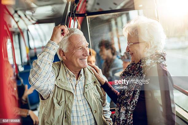 mature couple riding in a bus - public transport stock pictures, royalty-free photos & images