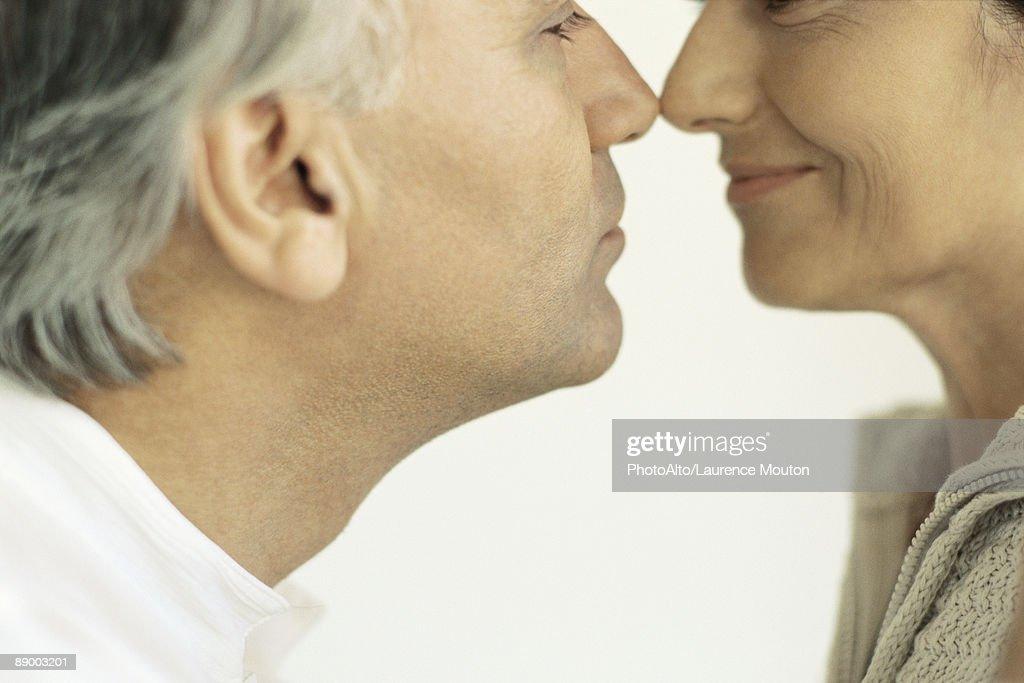 couples rubbing Mature