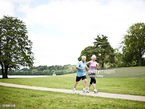 Mature couple running in nature
