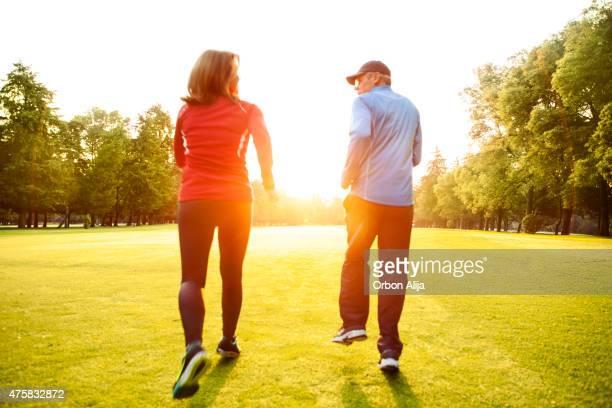 Mature couple running outdoors