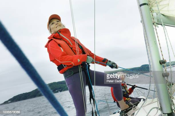 mature couple sailing boat - team captain stock pictures, royalty-free photos & images