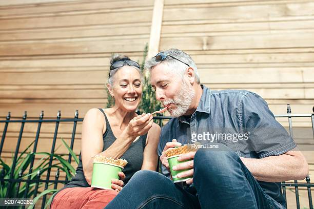 Mature Couple Sharing Ice Cream