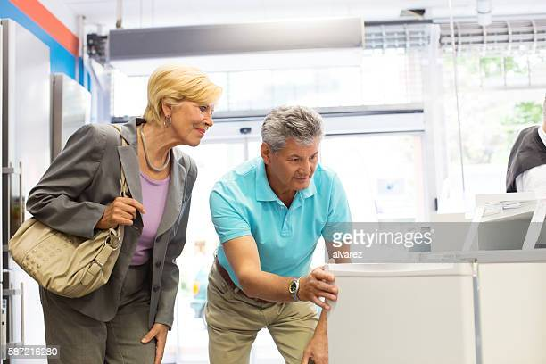 Mature couple shopping for appliances