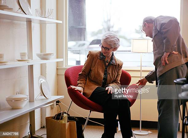 Mature Couple Shopping For Chair at a Modern Furniture Store