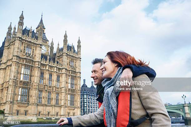 mature couple sightseeing on thames boat, london, uk - historical romance stock photos and pictures