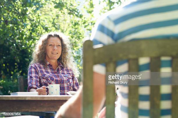 Mature couple sitting at their garden table