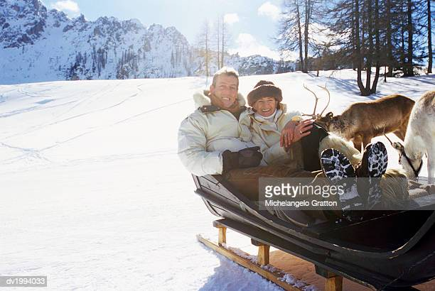 Mature Couple Sitting in a Sled