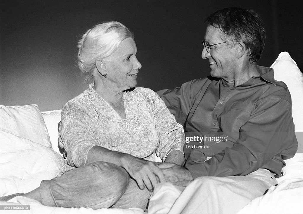 Mature couple sitting on couch, b&w : Stock Photo